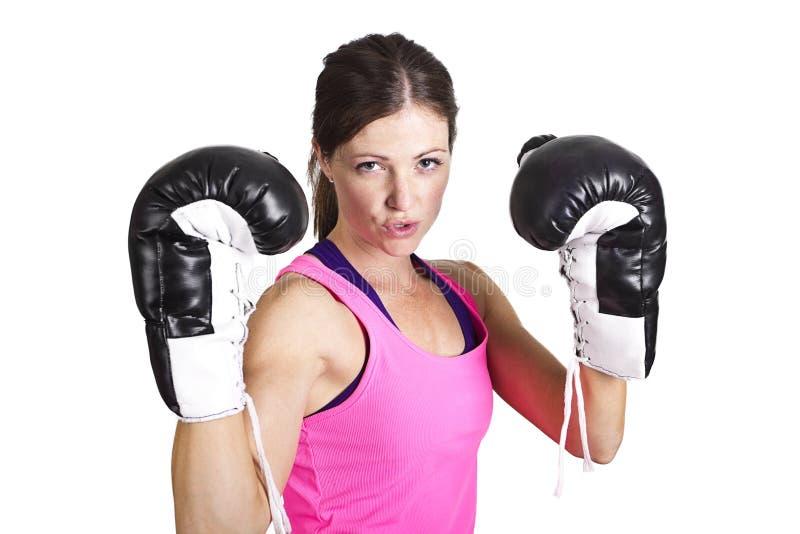 适合的被隔绝的妇女佩带的拳击手套 图库摄影