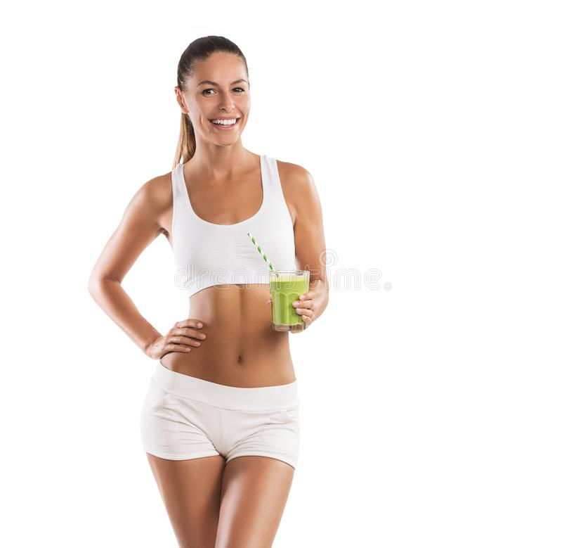 适合,拿着一名健康,绿色圆滑的人,在白色背景的美丽,少妇 免版税图库摄影