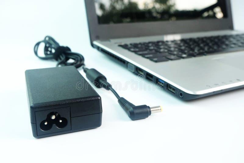 适配器便携式计算机电源线充电器在白色的 免版税库存照片