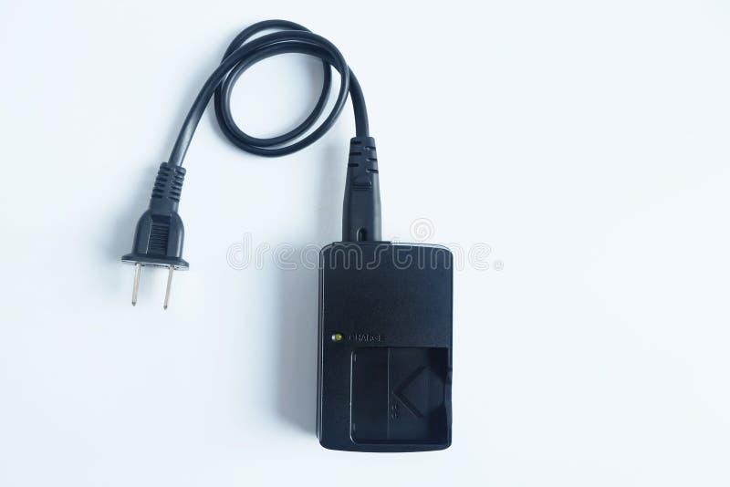 适配器力量在白色隔绝的照相机充电器电池 库存照片