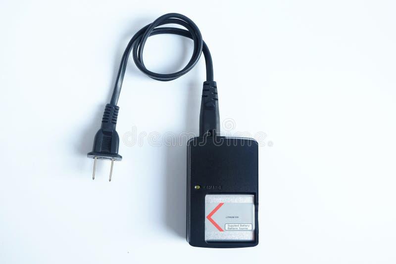 适配器力量在白色隔绝的照相机充电器电池 图库摄影