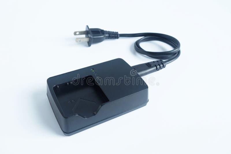 适配器力量在白色隔绝的照相机充电器电池 免版税库存照片