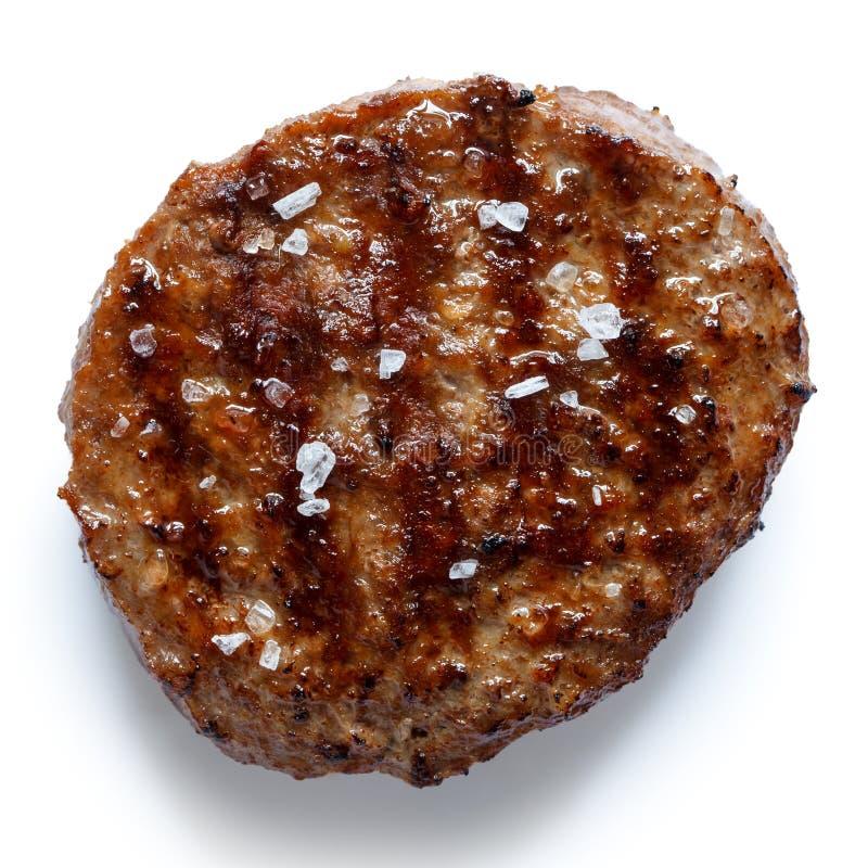 选拔与在白色隔绝的盐的烤汉堡包小馅饼从 库存图片