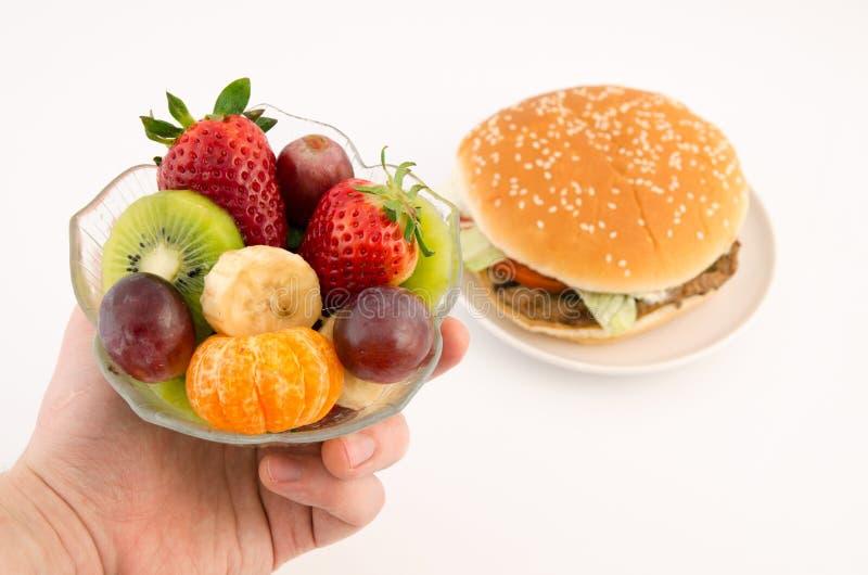 选择在汉堡包和果子之间 库存照片