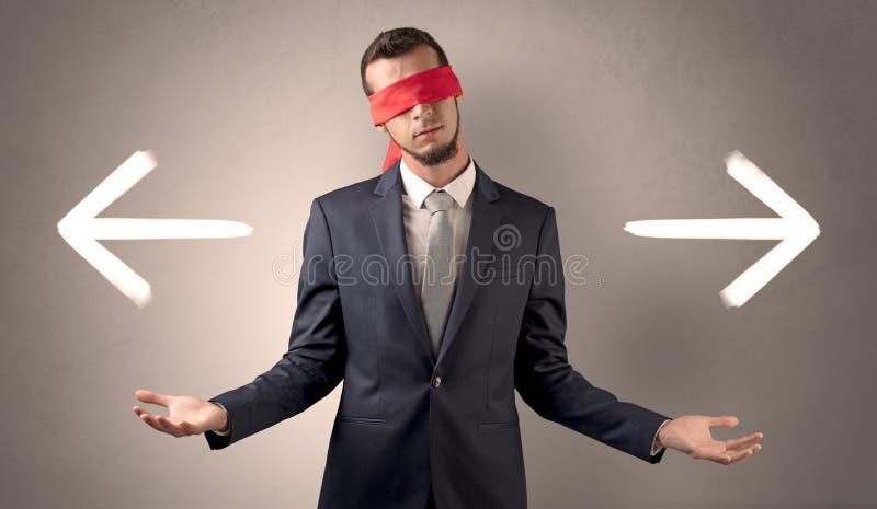 选择方向的被盖的眼睛商人 免版税图库摄影