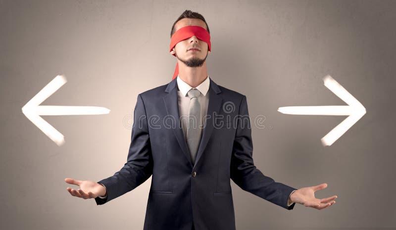 选择方向的被盖的眼睛商人 库存图片