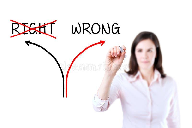 选择而不是正确一个的错误方式 查出在白色 免版税库存照片