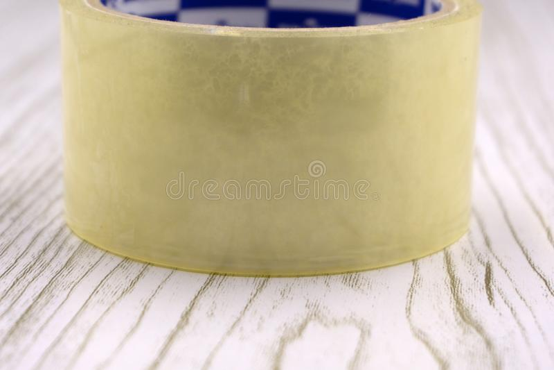 透明胶带卷在白色的 库存照片