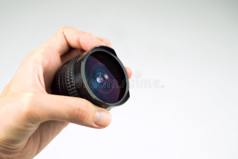 透镜在手中 免版税库存图片