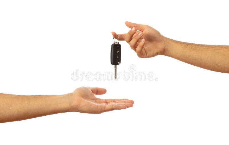 递关键字的汽车 在白色背景隔绝的手,裁减路线 库存照片