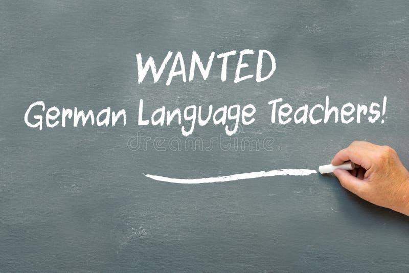 递在黑板被要的德语老师的文字 免版税库存图片