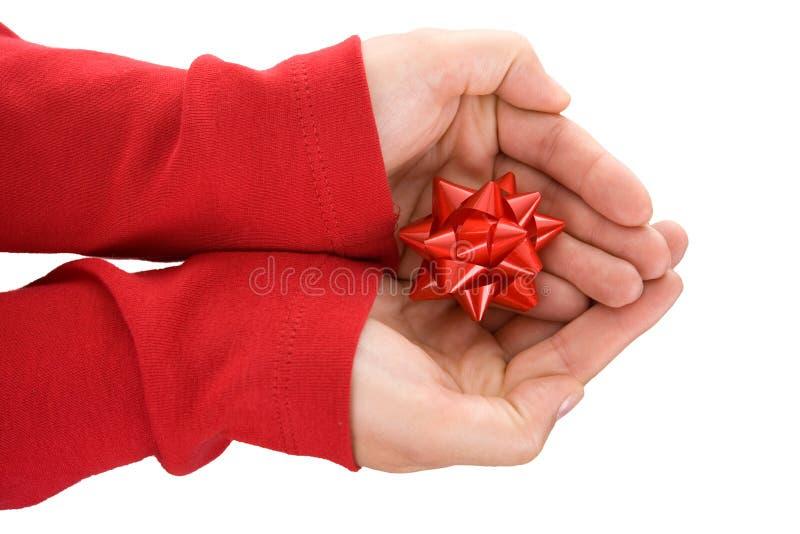 递她的藏品红色丝带妇女 库存图片