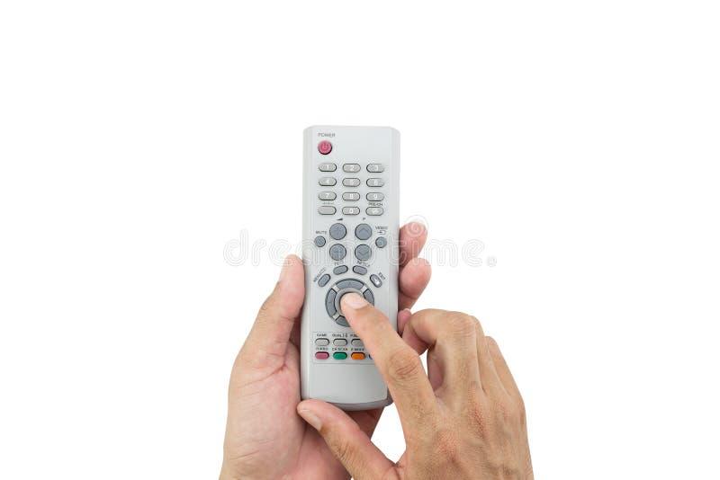 递对电视遥控负的男性亚洲被隔绝在白色backg 免版税图库摄影