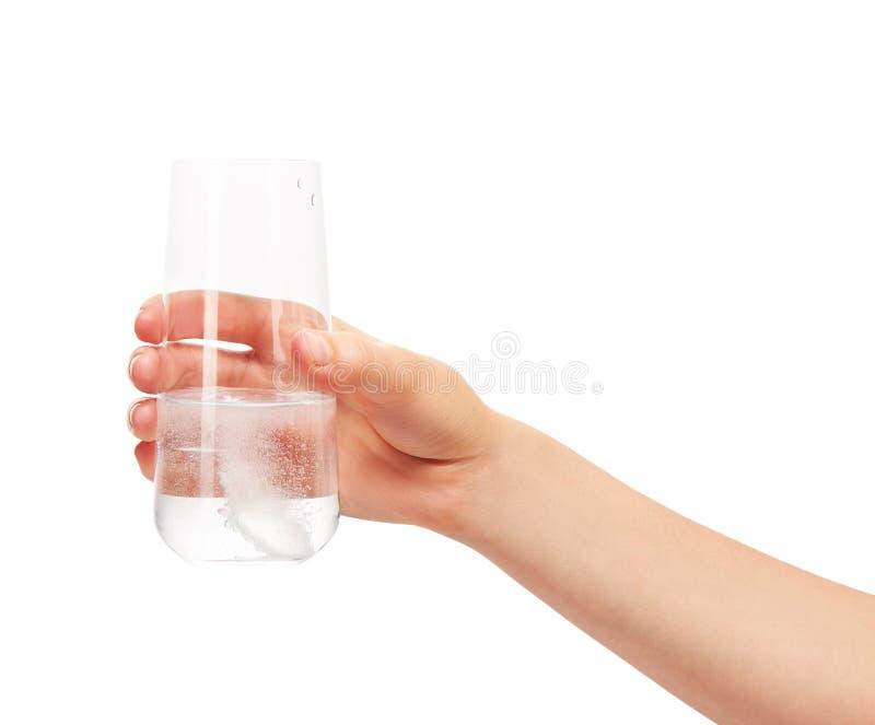 递对负玻璃与白色冒泡片剂在水中 图库摄影