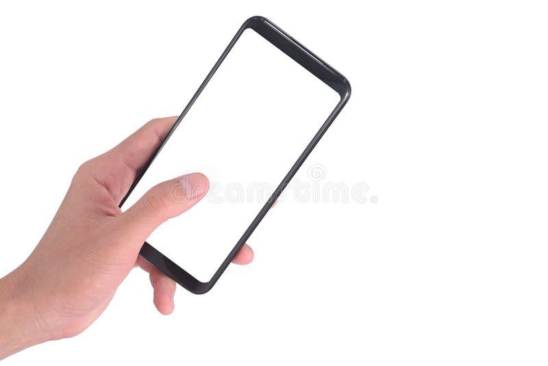 递拿着手机和使用在白色背景隔绝的触摸屏智能手机裁减路线的嘲笑的 免版税图库摄影