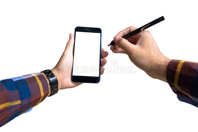 递拿着有行家衬衣的一个现代智能手机和指向 免版税库存图片
