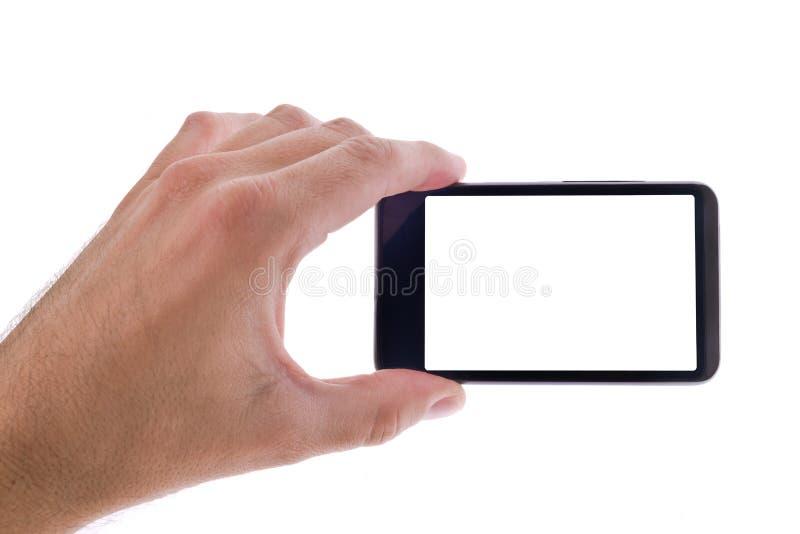 递拿着有黑屏的普通手机 免版税库存图片