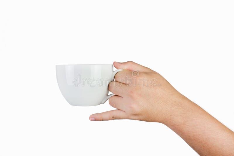 递拿着白色杯子被隔绝在白色背景 免版税图库摄影