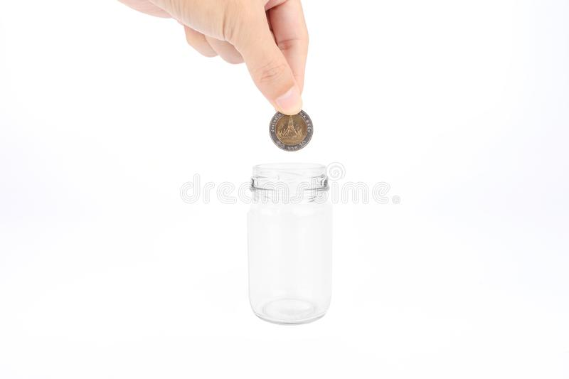 递拿着硬币被隔绝在白色背景,概念事务 免版税库存图片