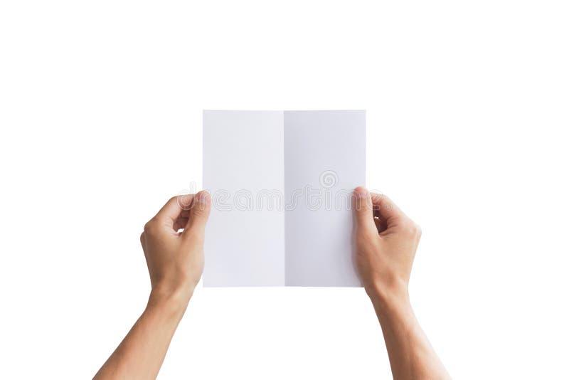 递拿着空白的小册子小册子在手上 当前传单 库存图片