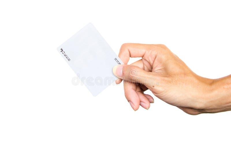 递拿着说笑话者在白色背景隔绝的游戏卡前面  裁减路线 图库摄影