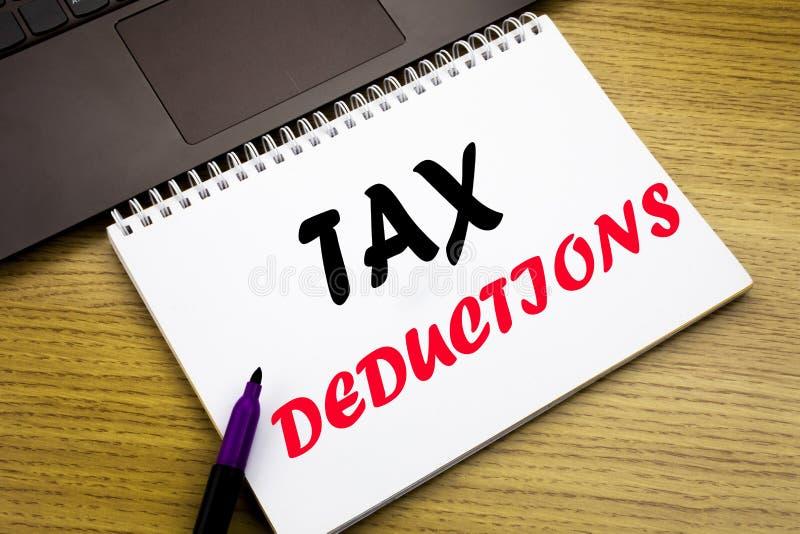 递文字文本显示税收减免的说明启发 书面的财务接踵而来的税钱扣除的企业概念  免版税库存照片