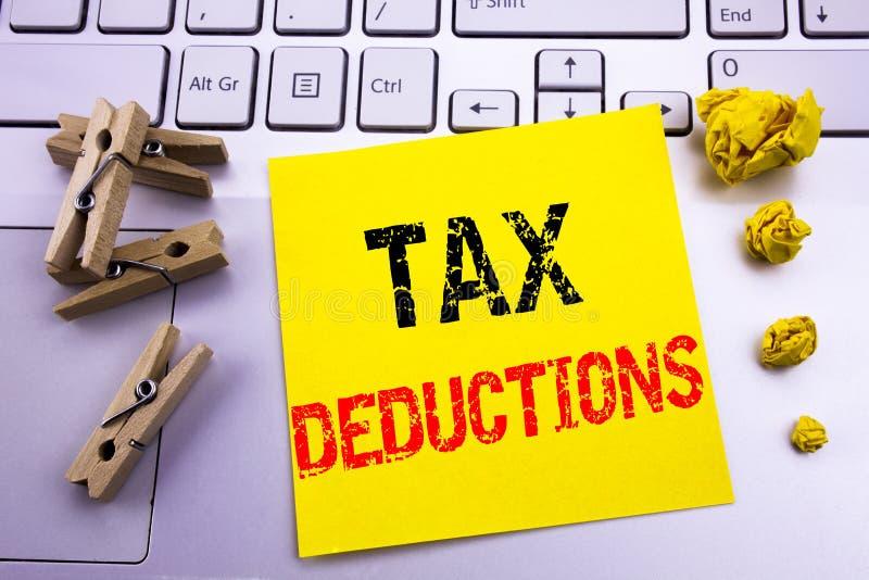 递文字文本显示税收减免的说明启发 书面的财务接踵而来的税钱扣除的企业概念  库存照片