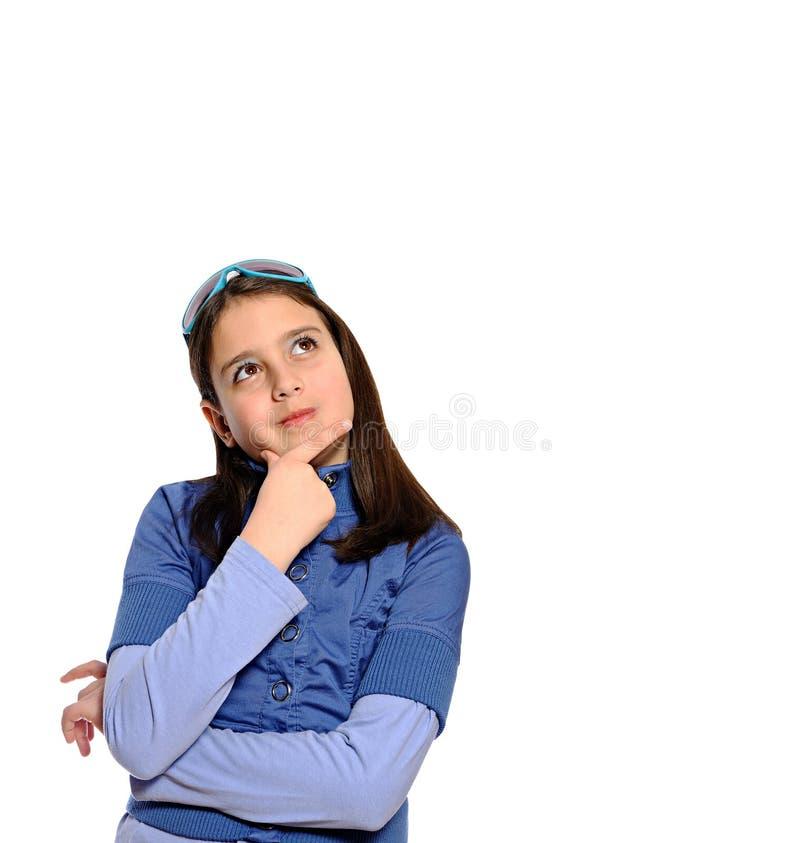逗人喜爱女孩姿势认为 免版税库存照片