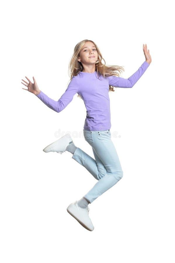 逗人喜爱女孩跳跃被隔绝的画象 免版税图库摄影