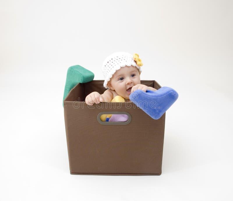 逗人喜爱婴孩的配件箱 免版税库存图片