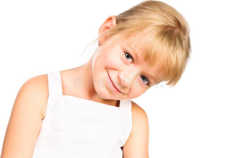 逗人喜爱小女孩微笑查出在白色 免版税库存照片