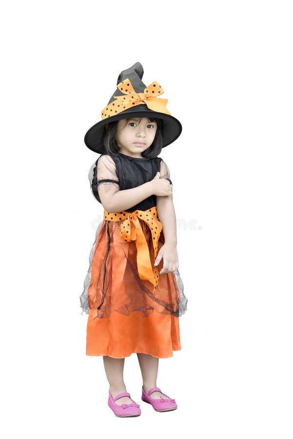 逗人喜爱的亚裔女孩画象有巫婆服装的为万圣夜 库存图片