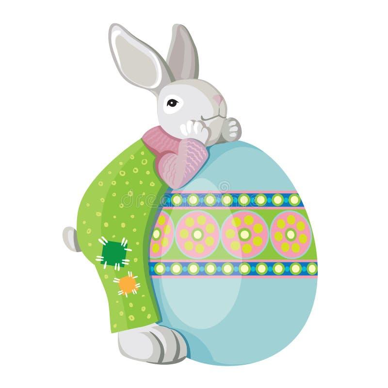 逗人喜爱的兔宝宝拥抱复活节绘了鸡蛋 : 皇族释放例证
