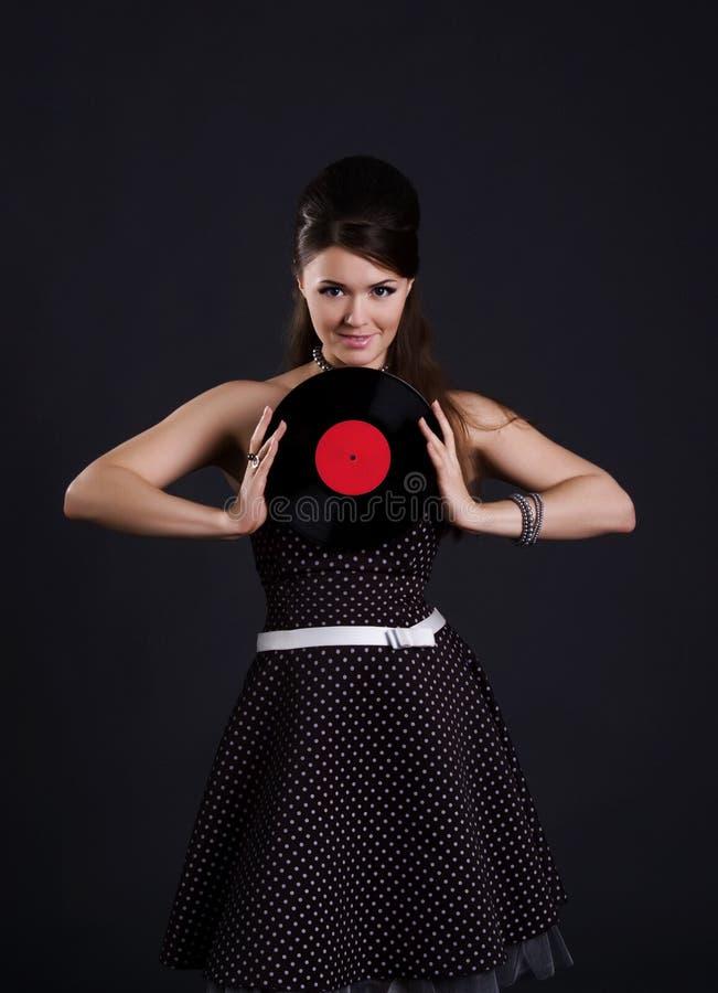 逗人喜爱的唱片妇女 免版税库存照片