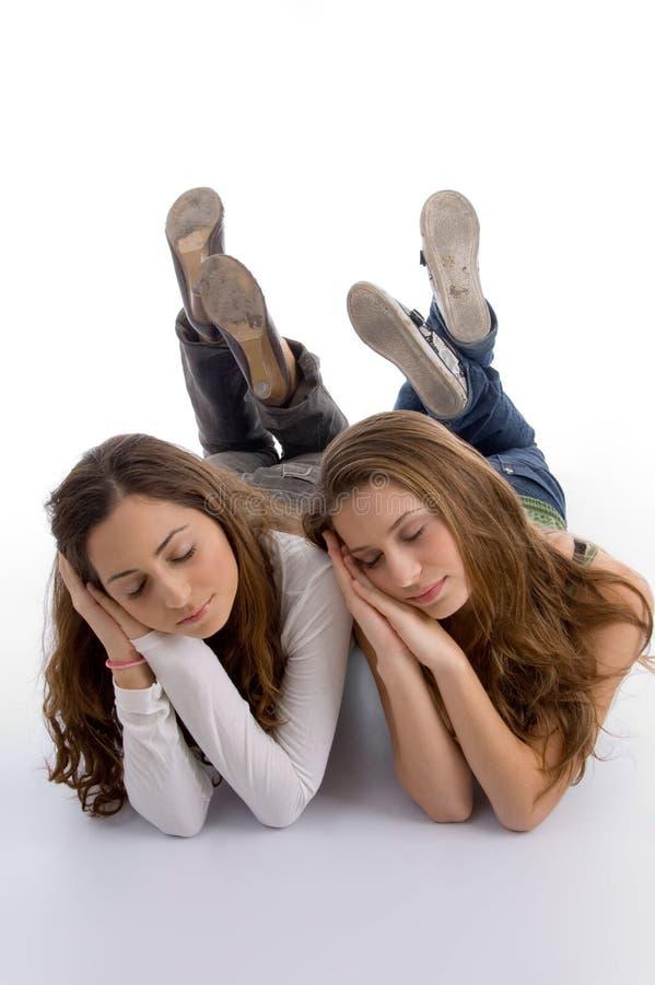 逗人喜爱的女孩休眠的少年 免版税库存图片
