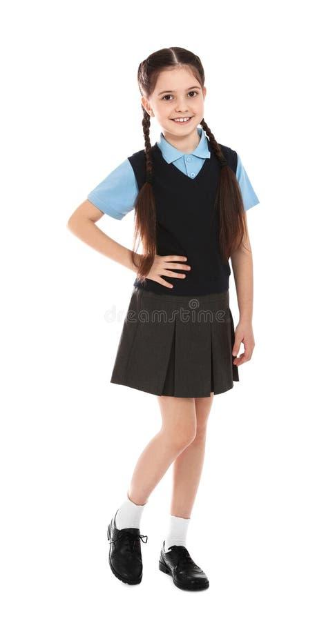 逗人喜爱的女孩全长画象校服的在白色 免版税库存图片