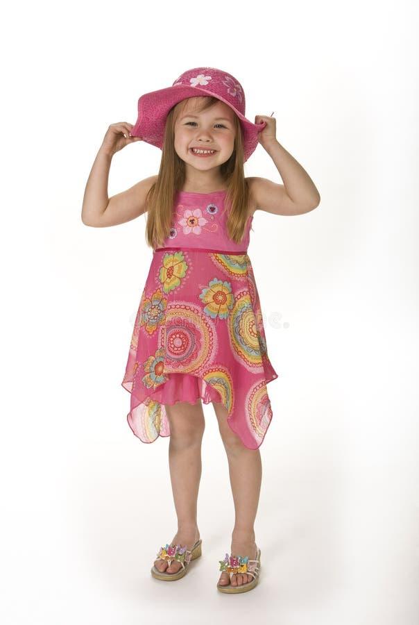 逗人喜爱的女孩夏天穿戴 免版税库存图片