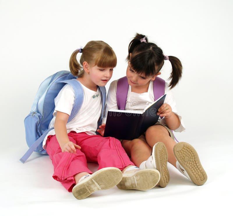 逗人喜爱的女孩学校 免版税库存图片