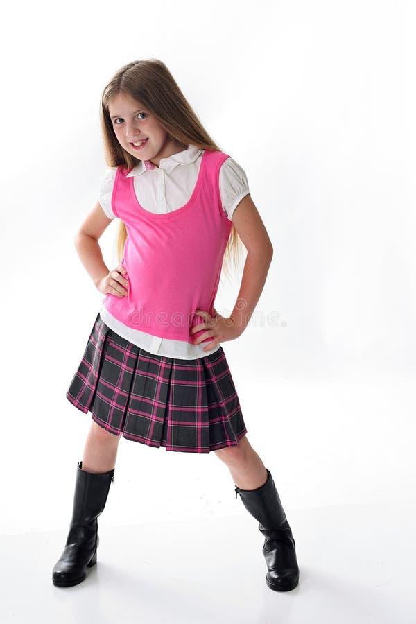 逗人喜爱的女孩少许桃红色学校 库存图片