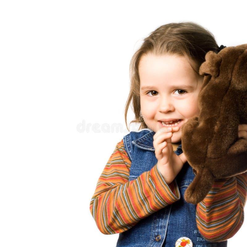 逗人喜爱的女孩少许玩具 免版税库存图片