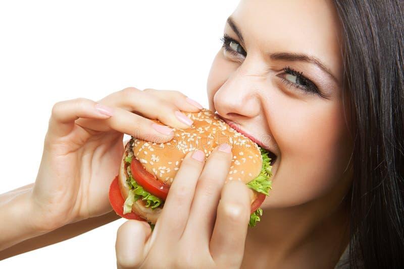 逗人喜爱的女孩尖酸的大汉堡包 免版税库存图片