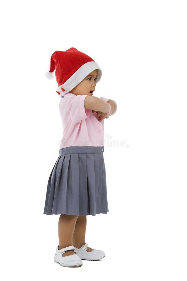 逗人喜爱的女孩帽子圣诞老人 库存图片