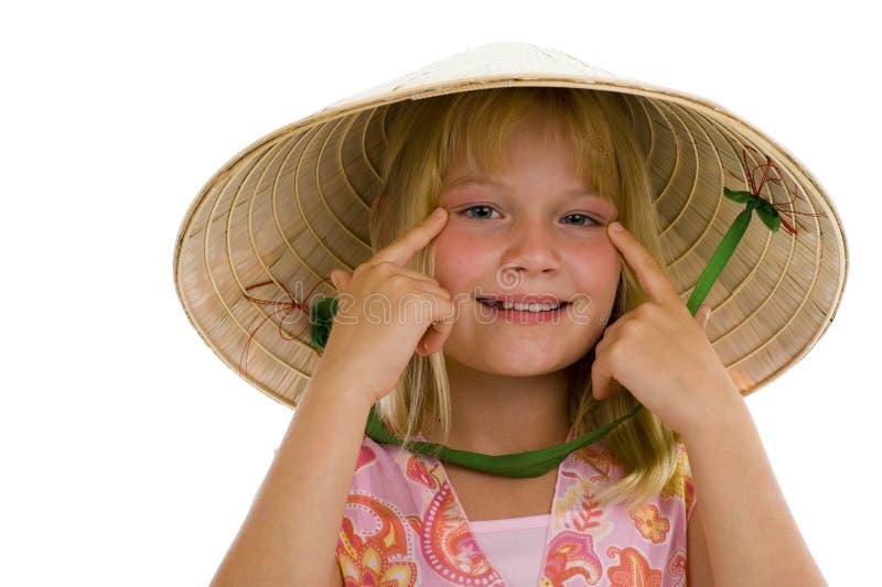 逗人喜爱的女孩帽子越南 库存图片