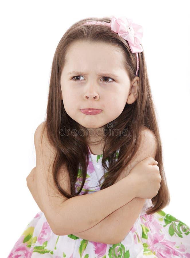 逗人喜爱的女孩淘气的一点 免版税库存照片