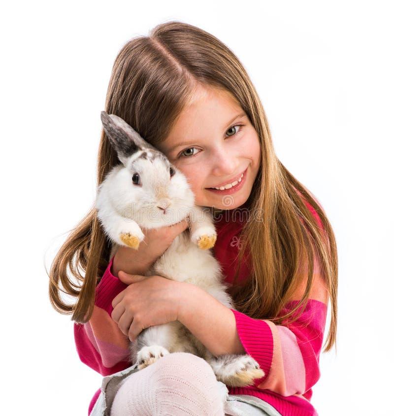 逗人喜爱的女孩用小兔子 免版税图库摄影
