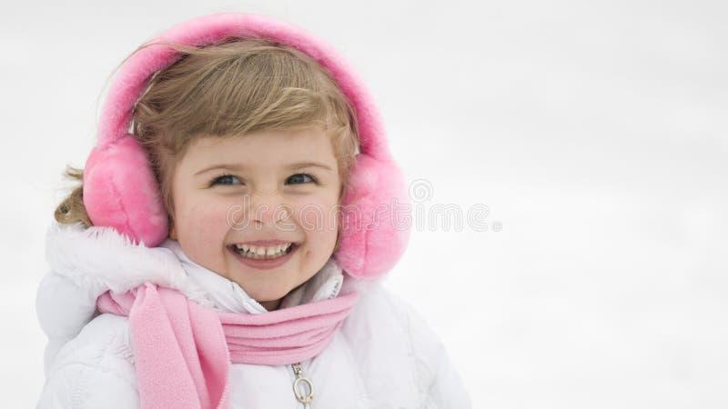 逗人喜爱的女孩纵向冬天 免版税库存照片