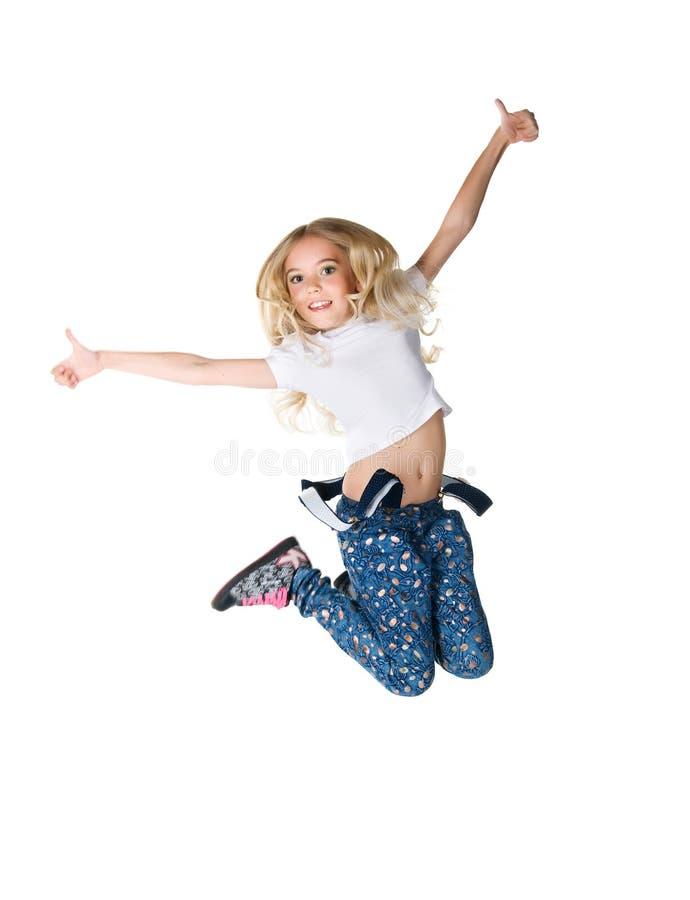 逗人喜爱的女孩跳一点 库存照片
