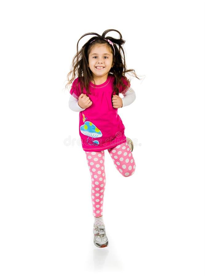 逗人喜爱的女孩跳一点 免版税库存图片