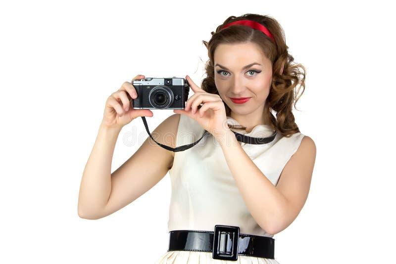 逗人喜爱的妇女的照片有照相机的 免版税库存照片