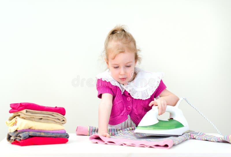 儿童电烙的衣裳 免版税库存照片